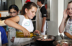 Kids Girl Pouring Olive Oil